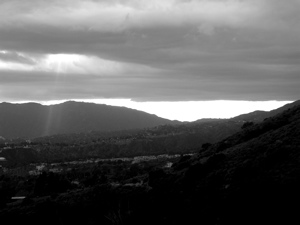 black and white photos of hills, clouds, and ray of light